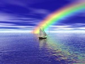 6679147-un-voilier-voile-vers-un-arc-en-ciel-vibrant